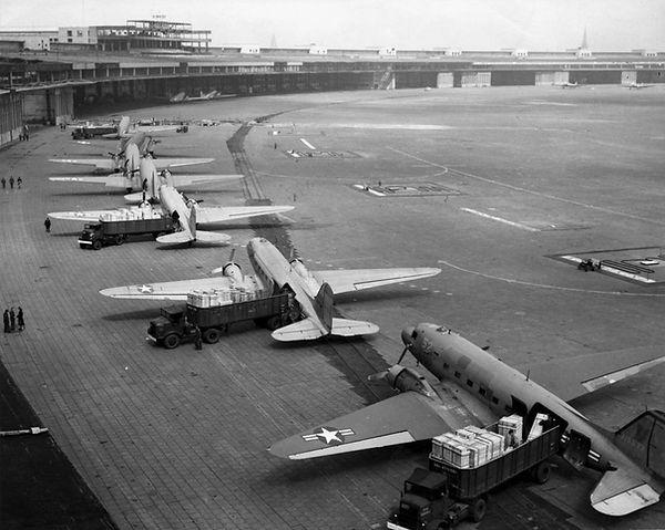 U.S. C-47 Skytrains unloading supplies a