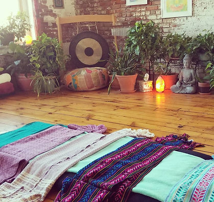 A relaxing scene at Vishnu's Yoga studio in Binghamton is shown set up for a postpartum rebozo cerrada.