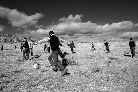 A Break for a Game On one side is Mount Süphan; on the other side is Lake Van and young men are playing between these two beautiful landscape features. Adilcevaz,Turkey 2016