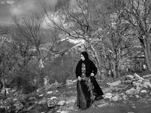 A woman is visiting the holy cemetery during the ceremony of Pir Şaliyar. Villagers gather for an ancient ceremony to honor the Zoroastrian dervish who lived in Hawraman in the 11th century CE . Hawraman, Iran 2019