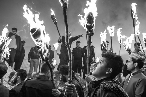 Newroz Spring Festival Men carry torches up the mountain to celebrate the Kurdish New Year. Akre, Iraq 2019