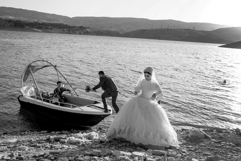 A Short Tour Before the Ceremony A couple is taking a boat tour in Lake Dukan before their wedding celebration. Dukan, Iraq 2019