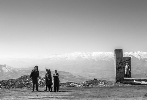 The people are looking at the view of the city along the road. Sanandaj, Iran 2019