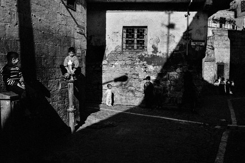 Game in Shadow Children playing games in the historic streets of Urfa. Urfa, Turkey 2011