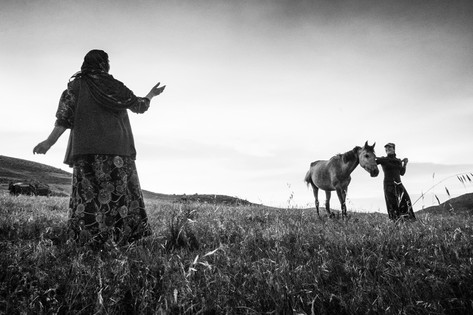 Beri Nomadic women returning to their tent after milking the sheep.  Half of the year is spent in the mountains and half near the cities. Hasankeyf, Turkey 2015