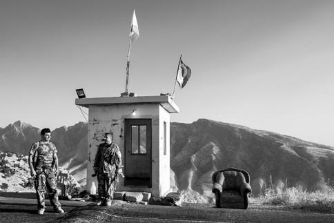 Peshmerga Two Peshmerga soldiers guard a mountain road checkpoint. Dukan, Iraq 2019