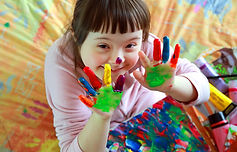 Cute little girl with painted hands.jpg