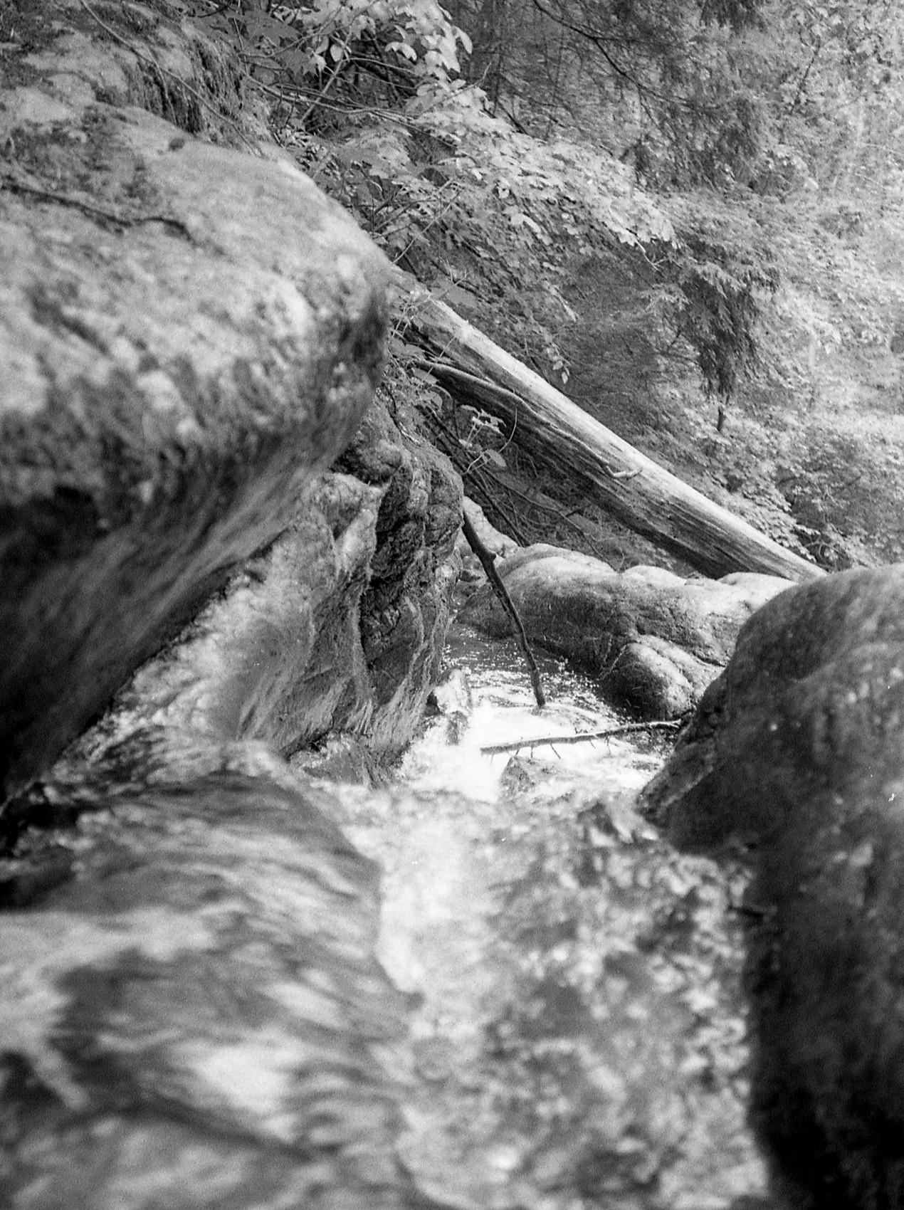 Water rushing towards a waterfall.