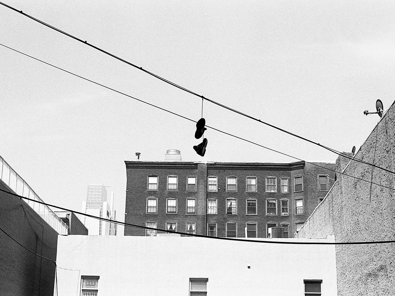 Shoes on wire.  Chinatown.  Philadelphia, PA.
