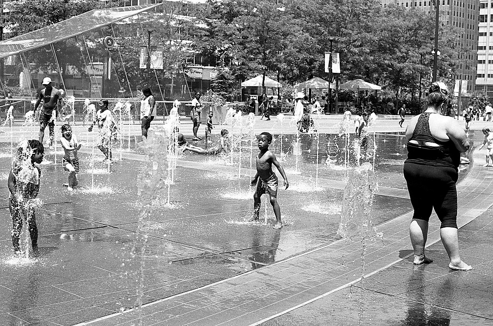 Kids playing in water fountain. Philadelphia, PA.