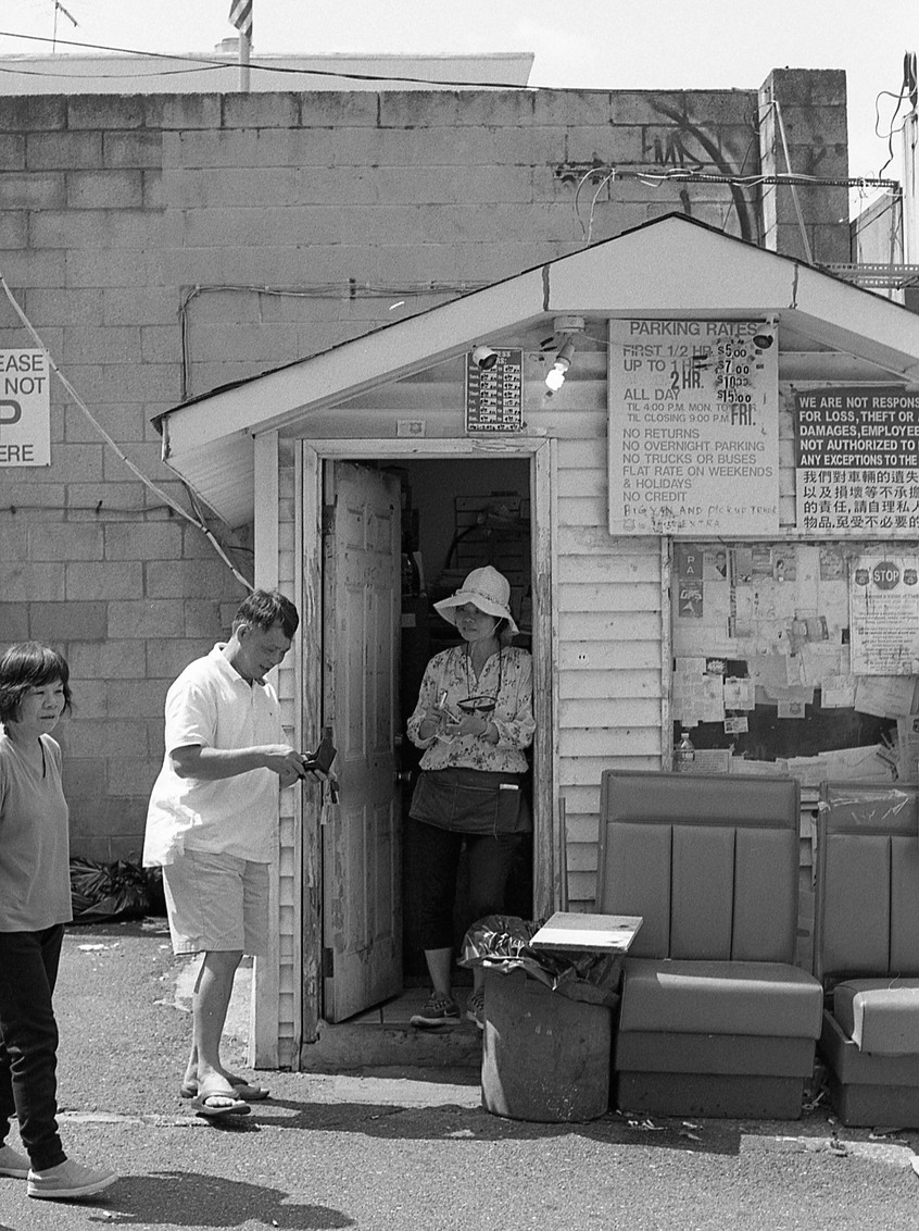Chinatown parking attendant.  Philadelphia, PA.