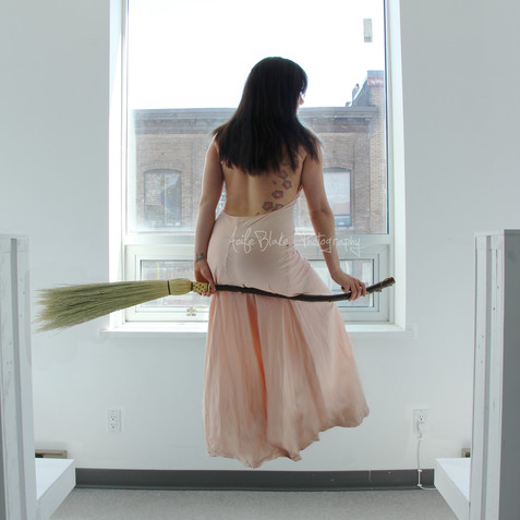 Floating Girl with Broom