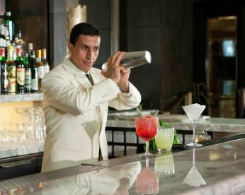 A barman at the Rib Room doing his thing