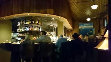 Bar surrounding the kitchen at Hugo's Restaurant