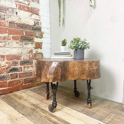 Reclaimed Dark Wood Rustic Log Coffee Table On Vintage Industrial Castors