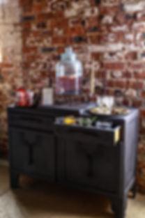 Dark Wood Dresser Bar Hire | Boho Furniture Hire | Event Furniture Hire | Wedding Prop Hire | Photo https://www.gourmandpixels.com