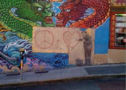 Banksy Peaceful Hearts.png