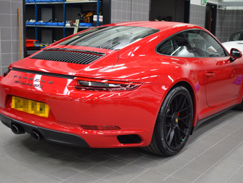 Starting its life correctly, this Porsche 911GTS receives a New Car Protection Detail