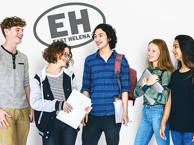 Three smiling students stand near an image of a circle filled with the letters EH and the words East Helena