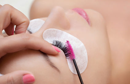 Eyelash extension procedure close up.jpg Beautiful Woman with long lashes in a beauty salon.jpg