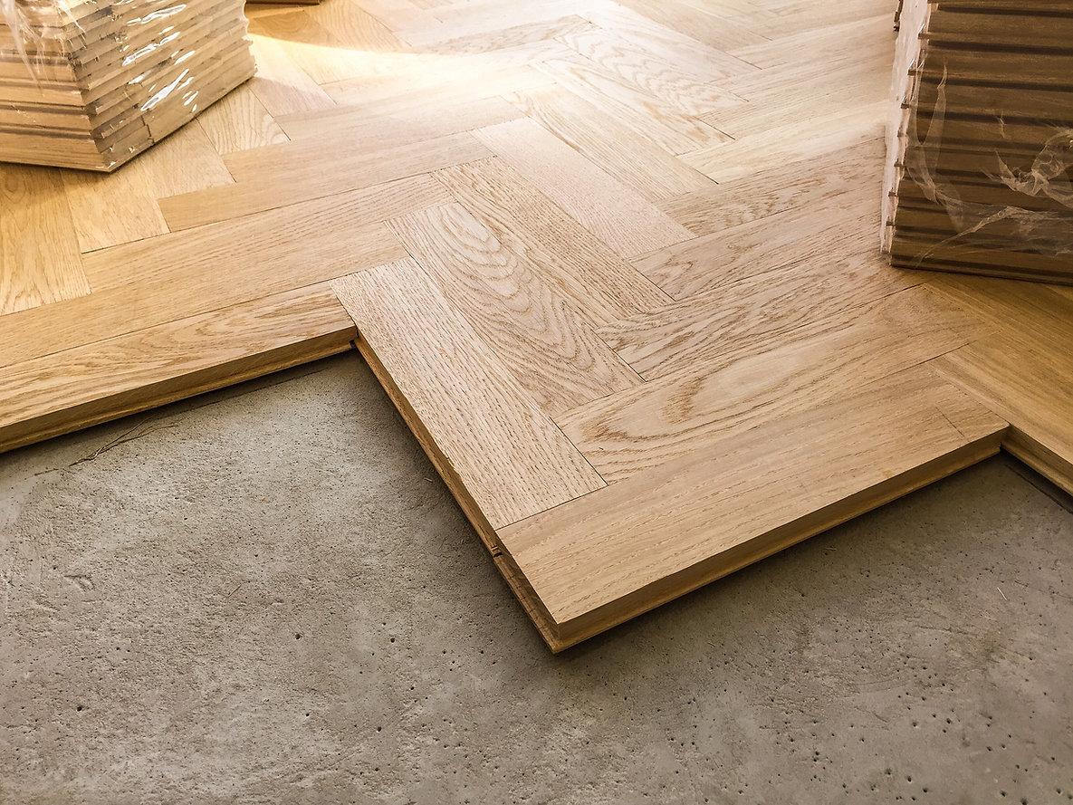 wood-parquet-flooring-being-laid-on-a-ki