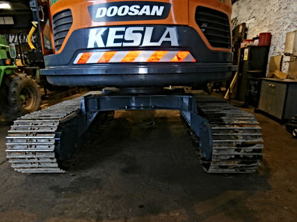 forestry conversion, tracked excavator, timber harvester, stroke harvesting head, zero tailswing, raised undercarrriage