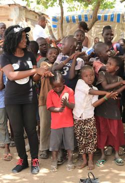 Nikki Laoye singing with the children CROP.jpg