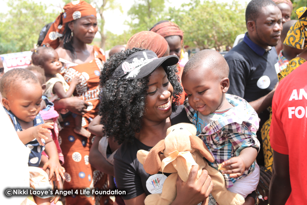 Nikki-Laoye-&-a-cute-baby-all-smiles-as-