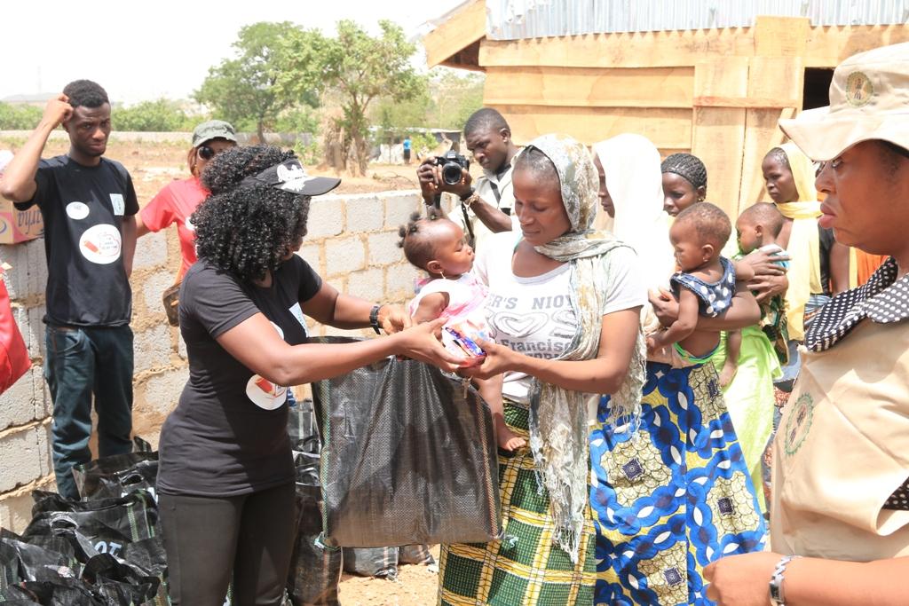 Nikki Laoye distributing relief items.jpg