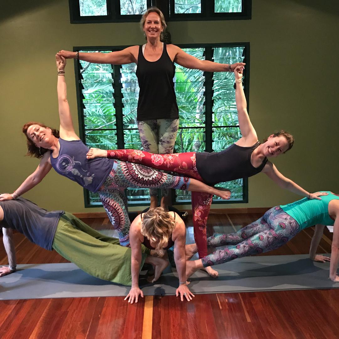 Group yoga pose photo at the Awakening Shakti Yoga Retreat
