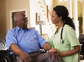 Nurse Speaking with a Disabled Man