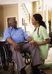 senior in wheelchair and caregiver