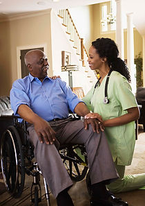 Nurse with patient in-home.