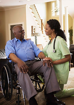 Nurse speaking with a man with disability