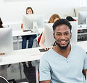 Portrait of smiling students in computer