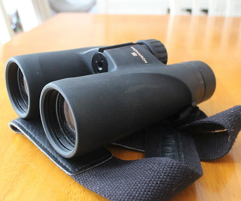 A pair of binoculars sitting on a table.