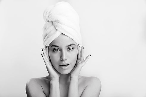 snapshot-of-healthy-beautiful-girl-in-white-towel-on-her-head-woman-with-green-eyes-touche