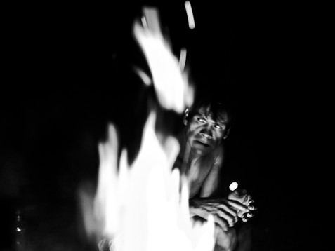 """In April, 2018, Aladino, a native Bora shaman, is in one of the night sessions of conversation with the spirits inside the Bora """"maloca"""", near the village of Pebas, in the Amazon region. These sessions are to offer elements of the Bora tradition such as the coca plant, tobacco and """"ampiri"""" (a mixture of tobacco with salt from forest trees). Only by doing all that, he can ask the spirit's protection and to keep his enemies from rival tribes away from him and his family."""