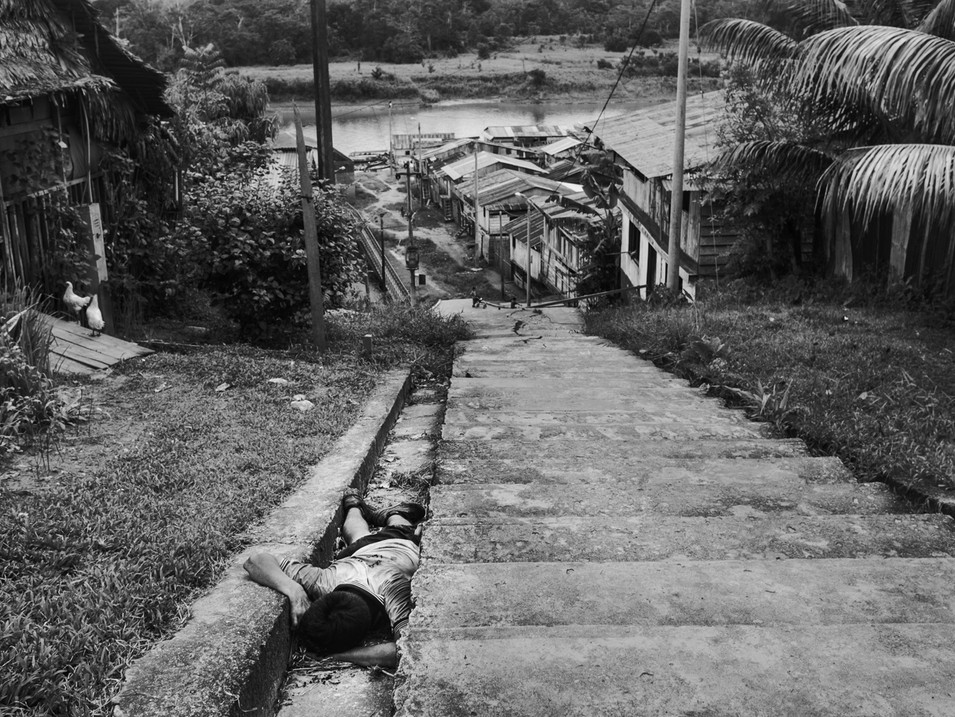 In November, 2015, in the early morning, a man is lying unconscious into a ditch in the village of Pebas, Amazon region. The probable cause is heavy drinking all day long. The Amazon people suffer from strong alcoholism due the lack of work and loss of their own culture.