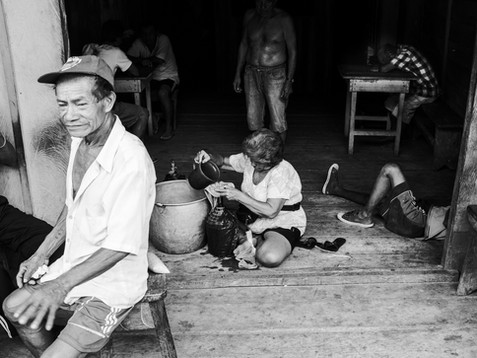 In November, 2016, a scene from a local bar in the village of Pebas, Amazon region. The man in the front is Aladino's father, Don Mimico, who is also a shaman and taught his son everything. In the current days, with all the challenges for the indigenous communities, the alcohol became a curse, as they say. The scene with men on the ground or passed out can be seen practically every day and is an alert of the issues around the Amazon.