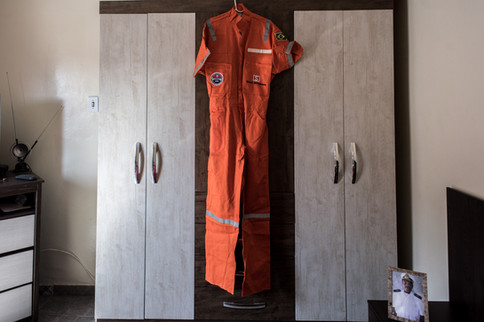 On July 29th, 2020 the uniform hanging from one of the cabinets is what is generally used by workers on an offshore oil exploration platform in the city of Macaé, state of Rio de Janeiro, Brazil. The clothing may represent the pride of working in the oil business, but today it is lying under the closet and without any sign of use, it represents the unemployment that today plagues the city that was once considered the national oil capital.