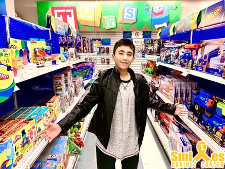 Alex with toys.jpg