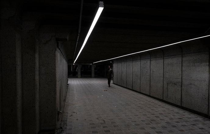 metro montreal street photography grey cinema alone men walking alone in the metro