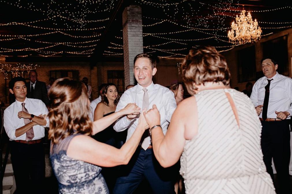 Groom dancing with Moms