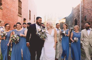 bridal party walking through Downtown Siloam Springs