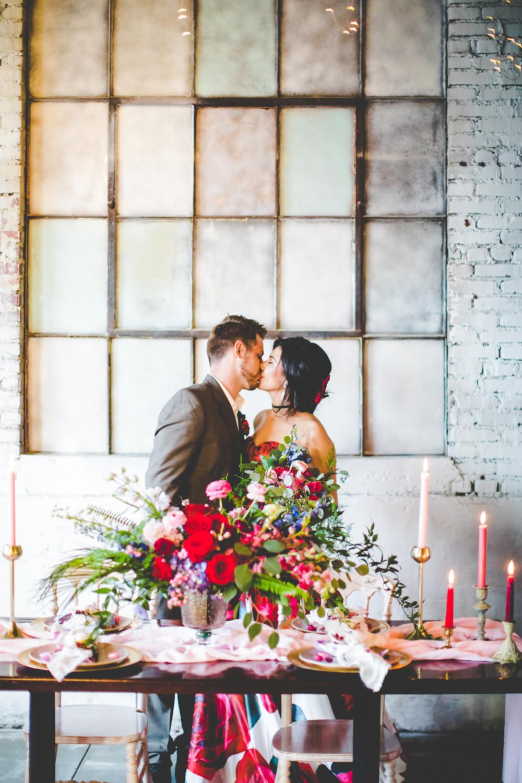 wedding kiss in The Brick Ballroom, northwest arkansas venues