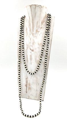Sautoir perles noires et vertèbres de poisson