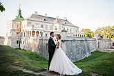 Fabulous wedding couple posing in front