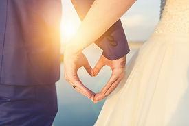 Wedding couple holding hands on sunset b