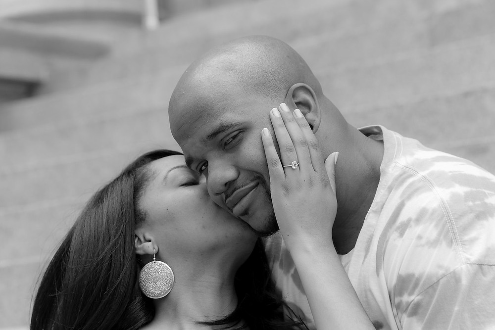 De'Shera gives a kiss and flashes her new, timeless engagement ring with Nic after their classic proposal in downtown Norfolk, VA.